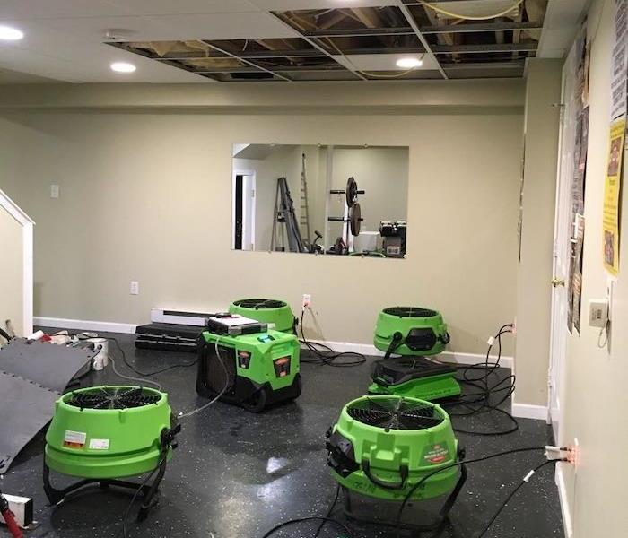 Commercial property with damaged ceiling and SERVPRO drying equipment