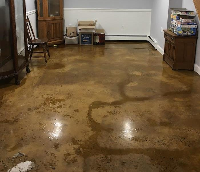 basement with wet floors from storm damage