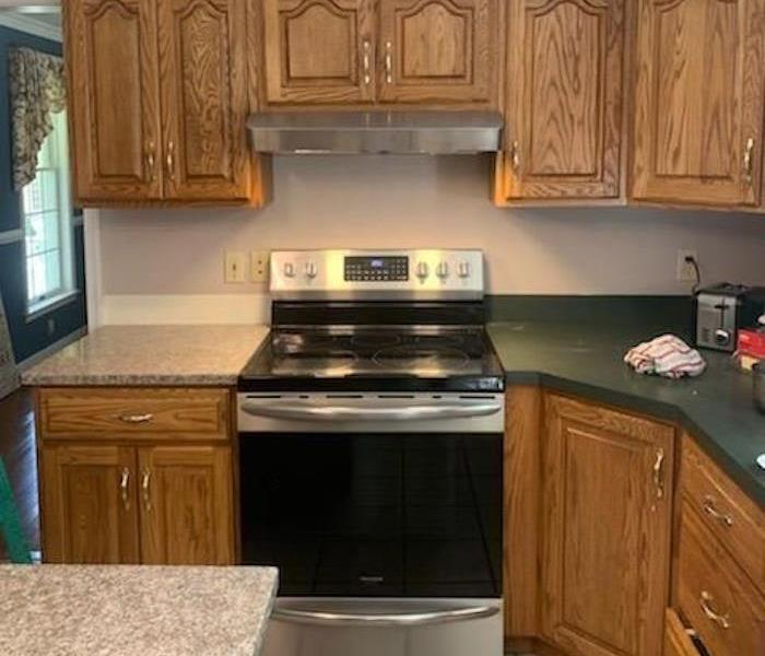 Clean kitchen with black stove