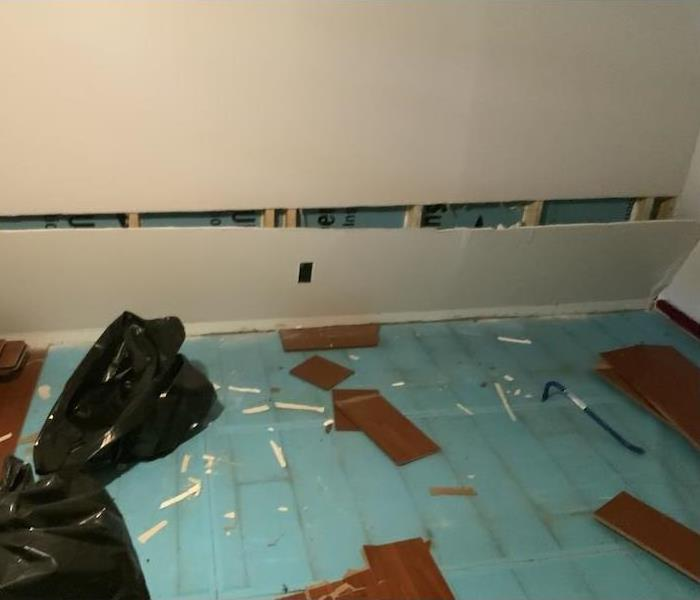 room with flooring floating in water on the kitchen floor