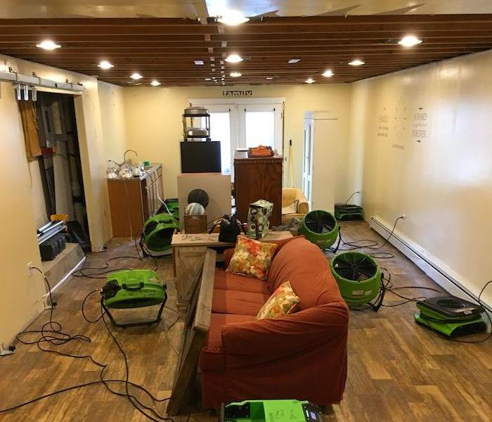 Room with SERVPRO drying equipment and open ceiling
