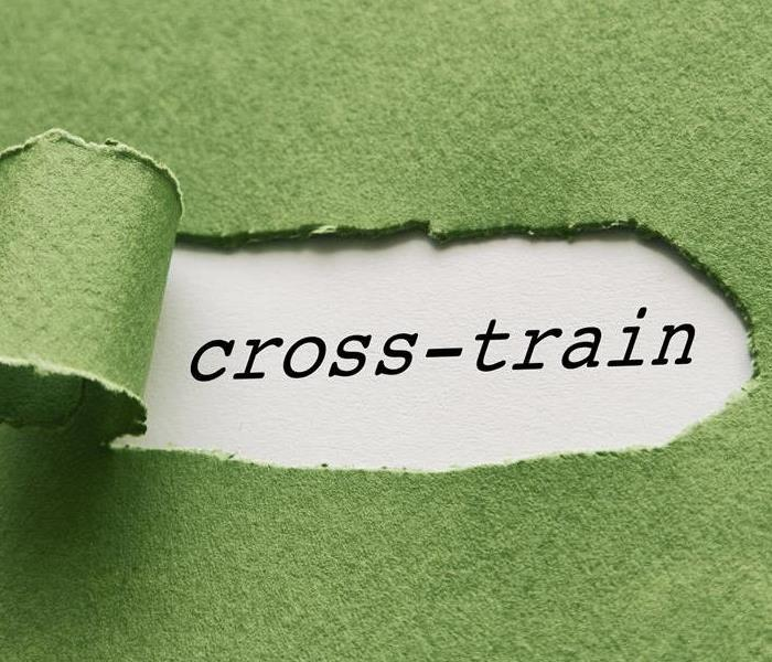 The words cross-train on a piece of paper with a green background