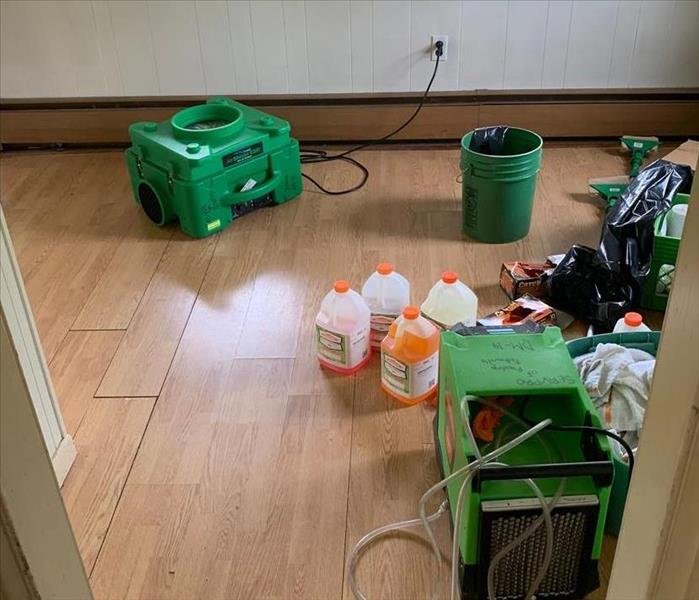 SERVPRO equipment on hardwood flooring of a home.