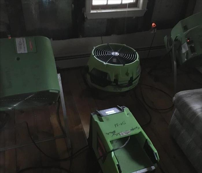 SERVPRO equipment on the floor of a room.